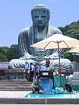 Sri Chinmoy sings and performs on the harmonium in front of the Kamakura Buddha